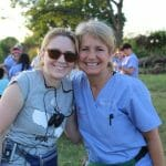 Photo of a mother and daughter volunteering with IMR | Family medical mission missions are ideal for serving together to benefit others.